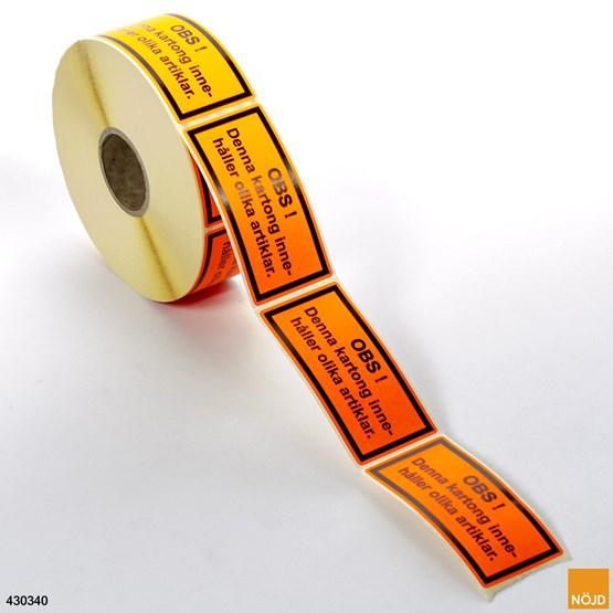 """Etikett """"Denna kartong innehåller olika artiklar"""""""